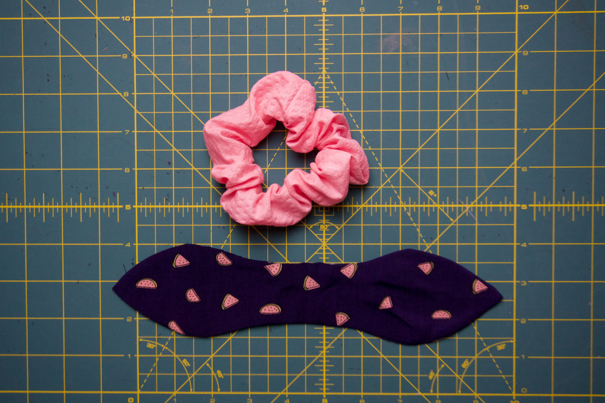 Bow beside a scrunchie.